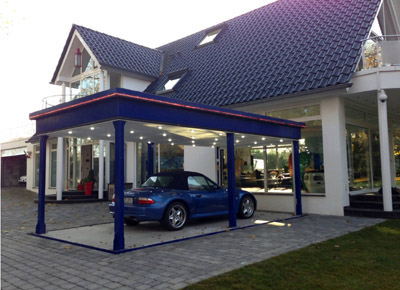 Car lift for private parking, the lift with the car outside the house.