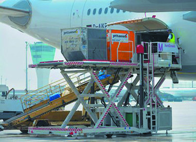 Electric transfer unit for loading aircraft.