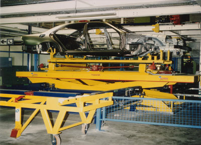 Lift table for skid transfer with automobile chassis.