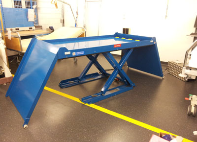 Ultra-flat lift table with two swing ramps.